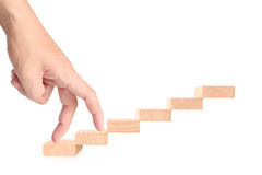 Hand liken business person stepping up  toy staircase Stock Photo
