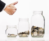 Hand likes  coins in bottle Royalty Free Stock Photos