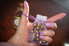 In the hand the lilac bag in the color of shellac nails Royalty Free Stock Image