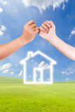 Hand linking finger and house icon Stock Photography