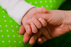 Hand of a little baby in mother's Stock Images