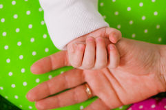 Hand of a little baby in mother's Stock Photo