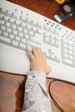 Hand of little boy child kid on the computer keyboard Stock Images