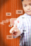 Hand of little Boys pushing YES. On touch screen interface Stock Photos