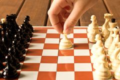 The hand of a little girl playing chess . Close up royalty free stock photography