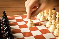 The hand of a little girl playing chess . Close up royalty free stock photos