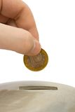 Hand load coin to bank Royalty Free Stock Photo