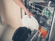 Hand loading dish washer Stock Images