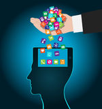 Hand loads icons head. Mobile apps installed into the brain, replacing the mind Stock Photos
