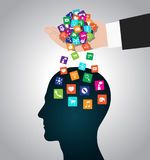 Hand loads icons head. Mobile apps installed into the brain, replacing the mind Royalty Free Stock Image