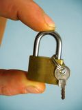 Hand and lock. Key and lock royalty free stock photos