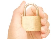 Hand lock. Hand holding a padlock, for concepts like security, care, insurance and safety - isolated on white Stock Images