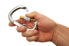 Hand and locking carabiner stock image