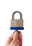 Hand locking padlock Royalty Free Stock Image