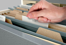 Hand Looking Though Filing Cabinet Drawer Stock Photo