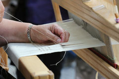 Hand loom weaver's hands Stock Image