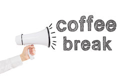 Hand with a loudspeaker. A hand holding a white loudspeaker, word 'coffee break' out from it. Side view. White background. Concept of informing royalty free stock photos