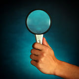 Hand with Loupe Stock Images