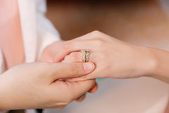Hand of lover are wearing a ring. On her wedding day Stock Image