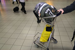 Hand luggage on cart in airport royalty free stock photo