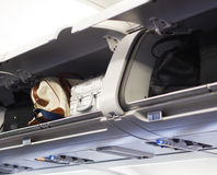 Hand luggage compartments. On a jet plane Royalty Free Stock Images