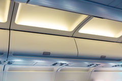 Hand luggage compartments. In the plane Royalty Free Stock Photos