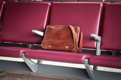 Hand luggage on the empty chair at the airport royalty free stock photos