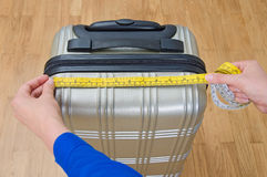 Hand luggage measurement. Royalty Free Stock Photography