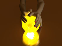 Hand and Luminous globe Stock Photos