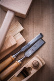 Hand lump hammer planer metal firmer chisels and wooden stud on. Wood board construction concept Royalty Free Stock Image