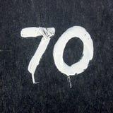 Hand målat hus nummer 70 Arkivfoto