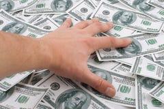 hand många pengartaken Fotografering för Bildbyråer
