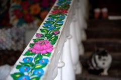Hand-m?lade hus med blom- motiv, arkivfoton