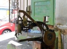 Hand machine cobbler. Cranked shoe repair machine in the workroom royalty free stock photos