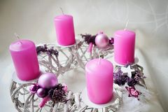 Hand made advent wreatch with pink christmass balls and candles. Hand made advent wreatch with pink christmass balls, cones, stars  and candles Royalty Free Stock Image