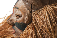 Hand made African mask with ropes simulating hair. Human face. I. Solated on white background Stock Photos