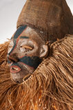 Hand made African mask with ropes simulating hair. Human face. I. Solated on white background Stock Photography