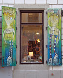 Hand-made art painted shutters window in Old Town of Bratislava Stock Image