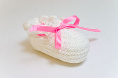 Hand-made baby's bootee Stock Image