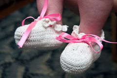 Hand-made baby's bootees Stock Photo