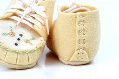 Hand made baby shoes. Close up of baby shoes from early 1900 Royalty Free Stock Photos