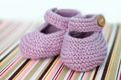 Hand-made baby shoes Stock Images