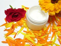 Hand-made beauty cream with flowers. (rose and calendula Stock Photography