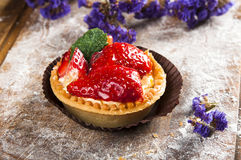 Hand-made berry cake on wood background Royalty Free Stock Images