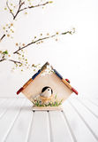 Hand made birdhouse with bird Stock Images