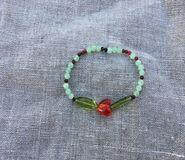 Red Heart bracelet. Hand Made bracelet with a heart bead crystal beads on a linen background Stock Photo