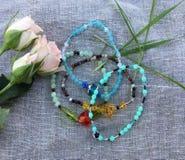 Four Bracelets. Hand Made bracelets on a linen background Stock Photography