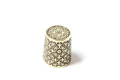 Hand made brass thimble with ornament. Hand made decorative brass thimble with etching ornament on the top and side Royalty Free Stock Photos