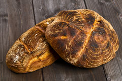 Hand made bread loaves on wooden table Royalty Free Stock Photography