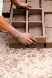 Worker making bricks stock image